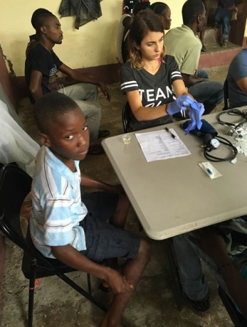 <p>A child seeks medical attention in a village in Haiti.</p>