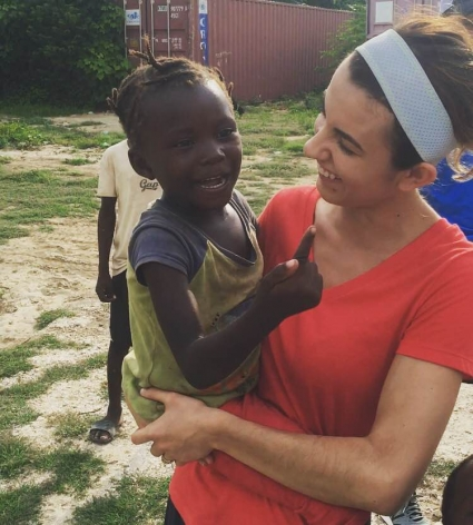 <p>Eve with a Haitian child</p>