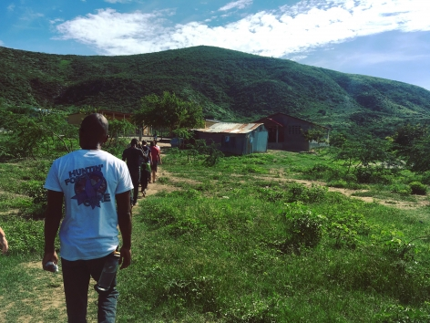 <p>Hiking to a site in a rural village to set up a makeshift medical center for the day</p>