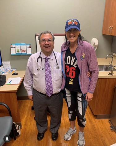 <p>Michele with her oncologist, Dr. Eric Weinshel, at Minnesota Oncology's Edina Clinic</p>